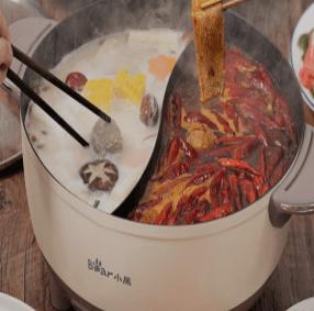 小熊电煮锅能炒菜吗